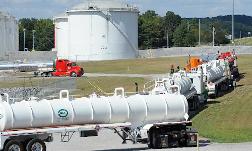 Trucks line up at a Colonial Pipeline facility in Pelham, AL.